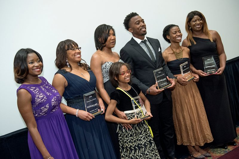Black Alumni Award winners line up with their awards