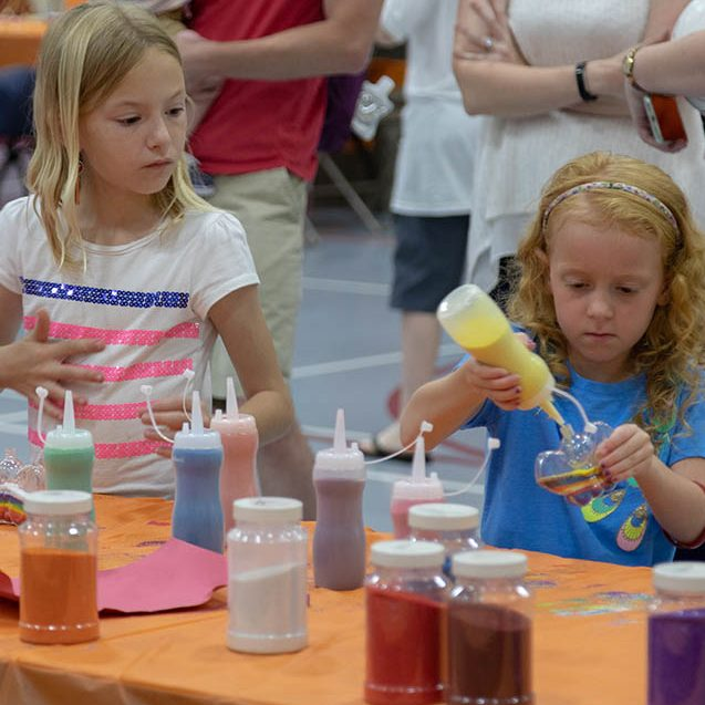 Kids do arts and crafts at the Kids Carnival at Reunion 2018