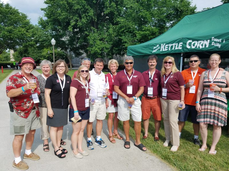 A group smiling Hokies at Reunion Weekend