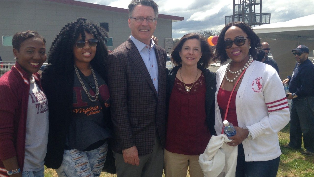 President Tim Sands and Dr. Laura Sands pose for a picture with Black Alumni Reunion participants