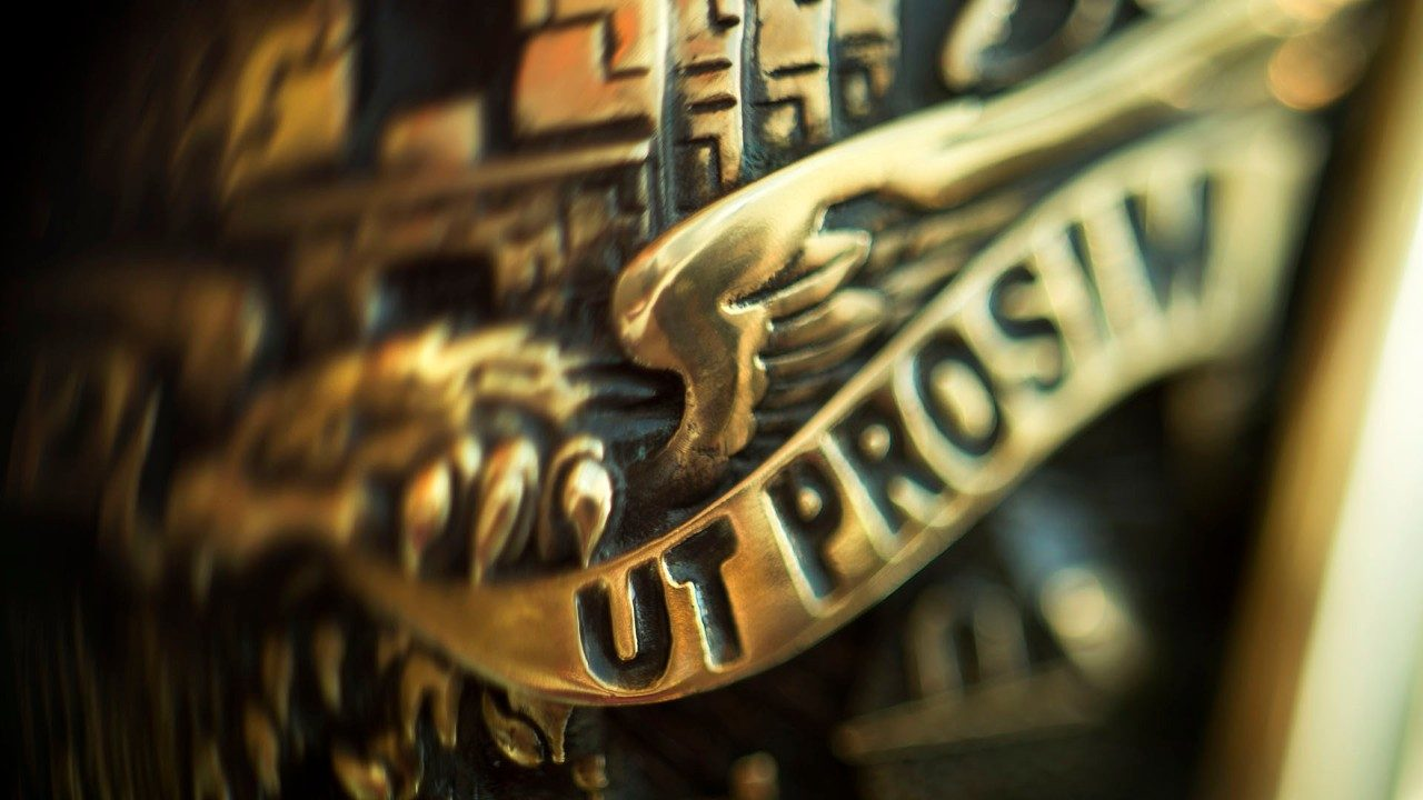 close up image of side of class ring highlighting the Ut Prosim motto of the university