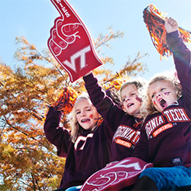 image of children dressed in virginia tech clothing and holding foam fingers and pom-poms