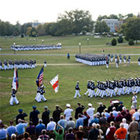 image of the corps of cadets marching in formation on the drill field